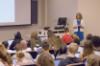 Kubatko stands in front of her classroom of students.