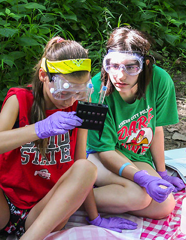 Young women explore biodiversity through science.