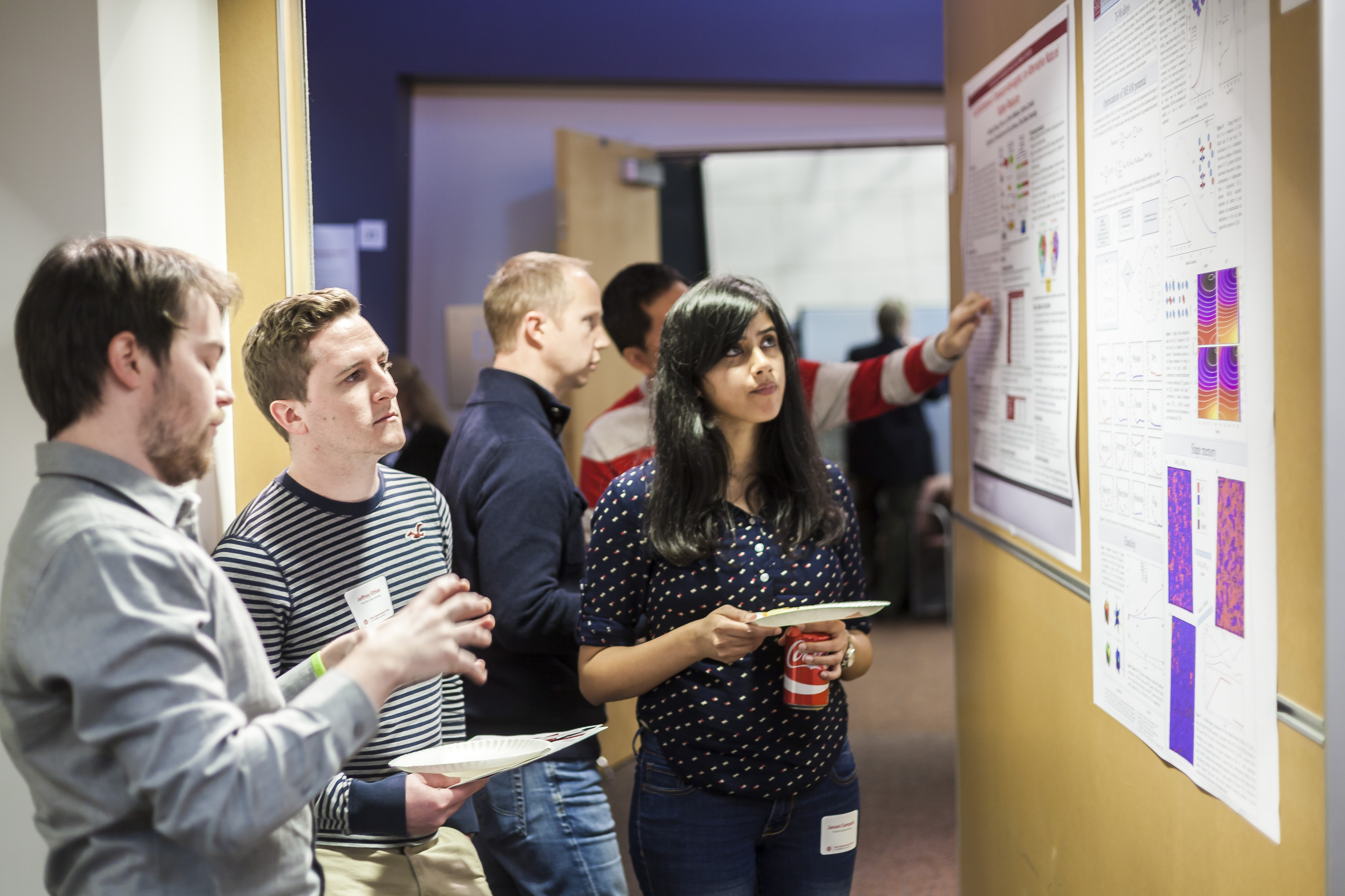 Attendees to the Dec. 3 SUG meeting discuss research during the Poster competition.